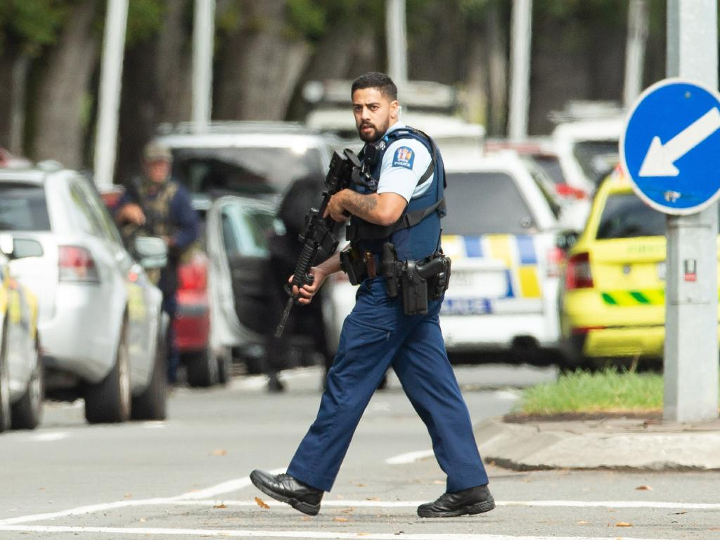 An armed police officer is seen following a shooting at the Masjid Al Noor mosque. Picture: AAP
