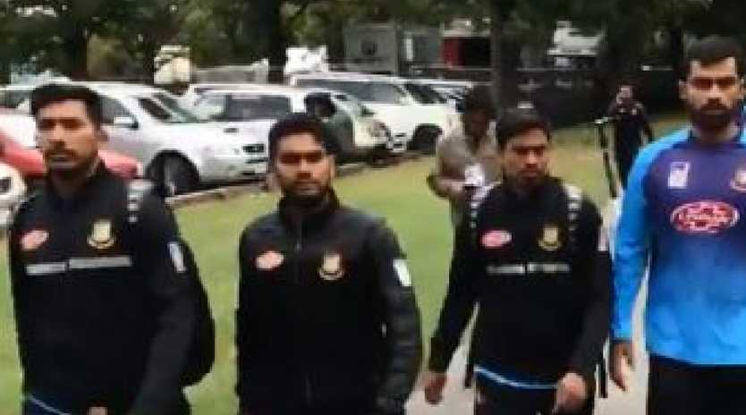 Bangladesh cricket players hurry away from the scene of the mosque shooting. Twitter @Isam84