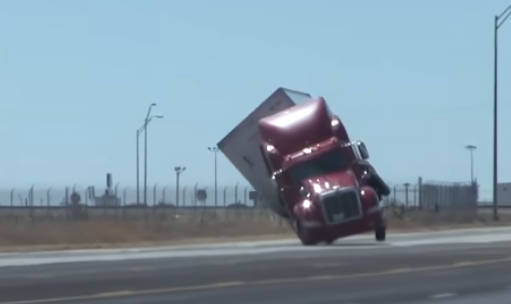 The truck was blown over by powerful winds.