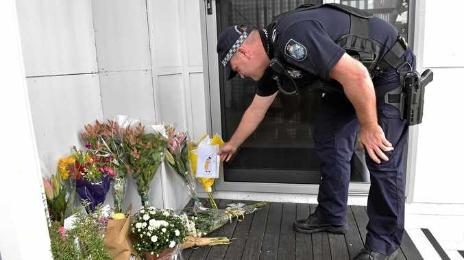 ONE LOVE: The local community will come together on Sunday night for a candlelit vigial to honour the 49 lives lost in the horrific terrorist attack at Christchurch. Senior constable Matt Clark reads messages of hope left at the Mosque of Sunshine Coast.