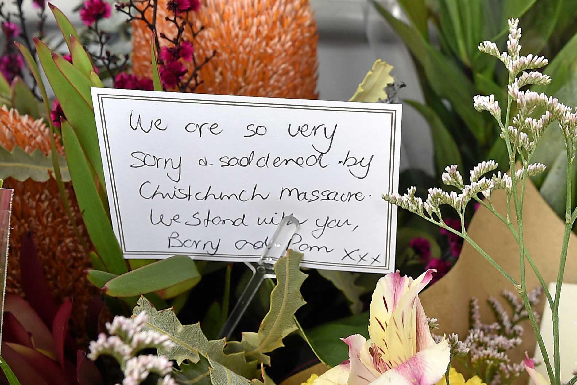 Senior constable Matt Clark reads messages of hope left at the Mosquem of Sunshine Coast.