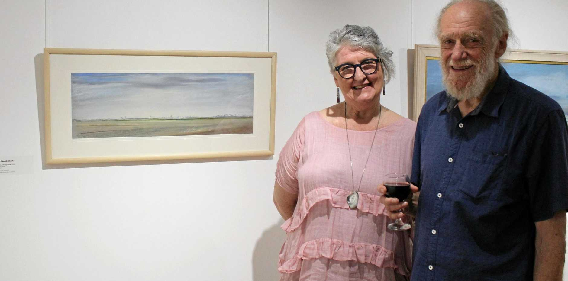 ON SHOW: Trish Callaghan and Mervyn Moriarty with one of Trish's artworks in the Response section of the Colour and Response exhibition at Gallery 107.