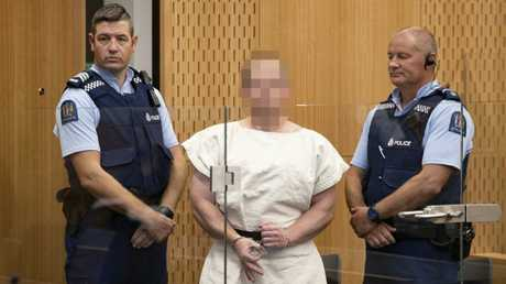 Brenton Tarrant making a sign to the camera during his appearance for murder in the Christchurch District Court. Picture: Mark Mitchell