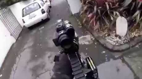 This screen grab of Brenton Tarrant wielding military-style weapons as he shoots through a Christchurch mosque.