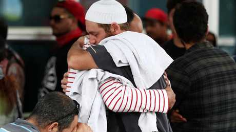 Friends and family of the victims gather at the support centre at the Hagley Community College in Christchurch. Picture: Fiona Goodall/Getty Images.