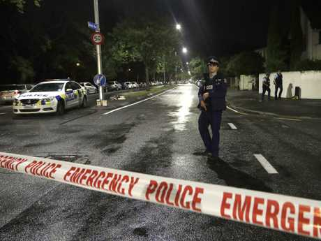 A police officer patrols the area where the shooting took place. Picture: AP