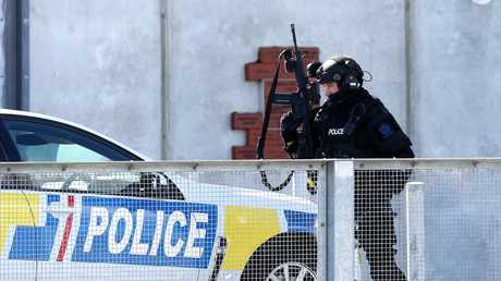 Armed offenders squad members and police monitor an incident at Forysth Bar. Picture: Dianne Manson/Getty Images