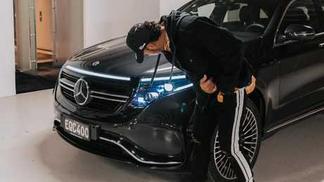 Hamilton inspects the new Mercedes-Benz EQC.