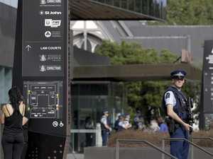 Aussie terrorist smiles in court