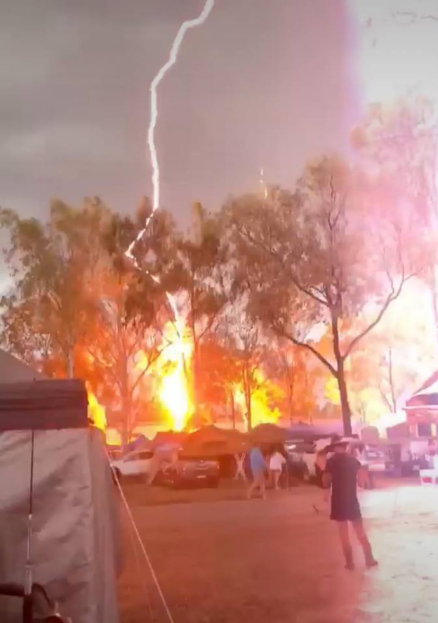 A camper captures the moment lightning strikes a tree at the CMC Rocks music festival at Willowbank.