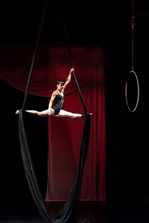 Marriana Joslin rocks the aerial ribbons in the world premiere of Small Town Talk at Curious Arts Festival.