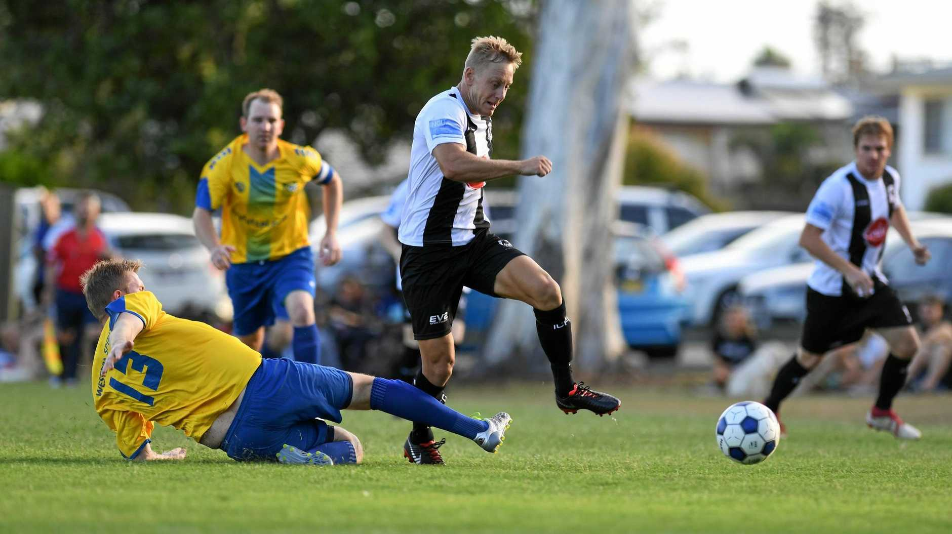 Western Spirit footballer Michael Wybranowski attempts a tackle on Ipswich City's Dane Grant during the recent local derby.