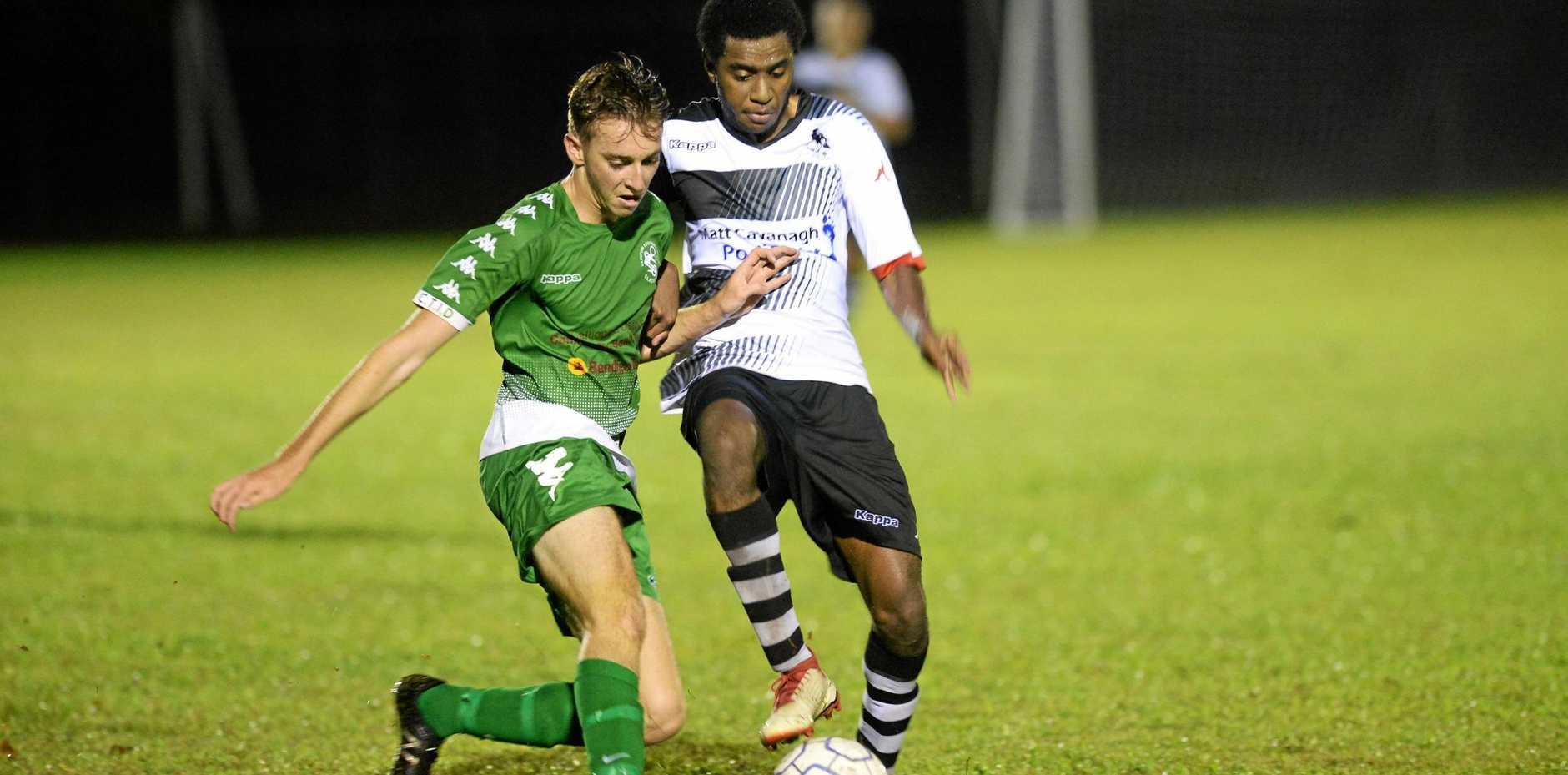 Soccer: Clinton FC's Shannon Evans and Nerimbera's Owen Tari.