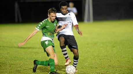 Soccer: Clinton FC's Shannon Evans and Nerimbera's Owen Tari.
