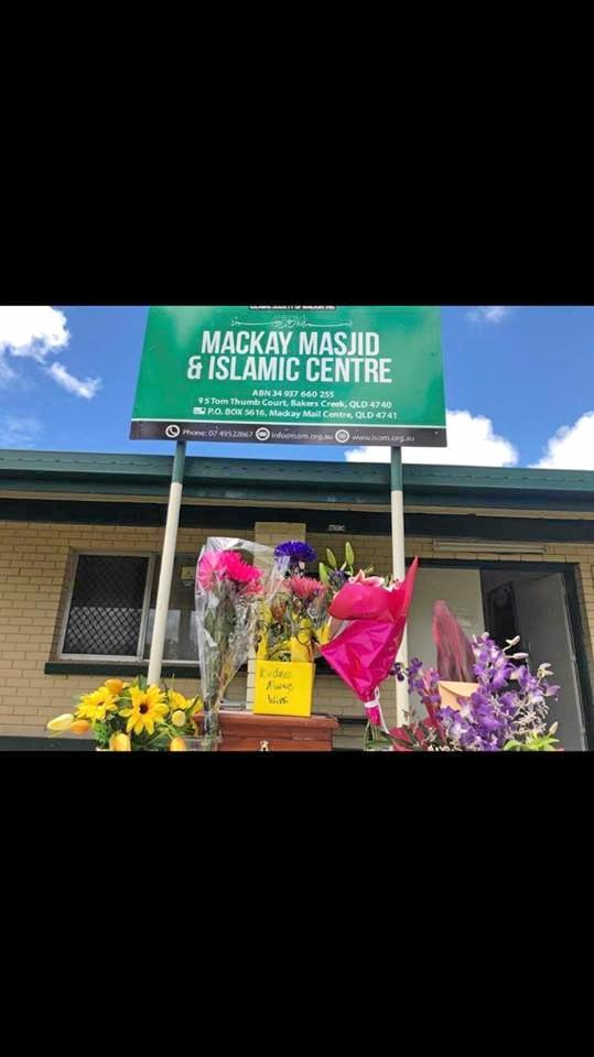 Flowers and messages of support for the Muslim community left at Mackay's Bakers Creek Mosque in the wake of the Christchurch attack.