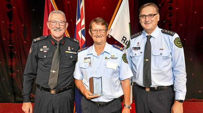 TOP BRASS: Assistant Commissioner Steve Barber, Volunteer of the Year Errol Noye and Director for Rural Fire Service in Gladstone, Craig Magick at the QFES Volunteer Conference.
