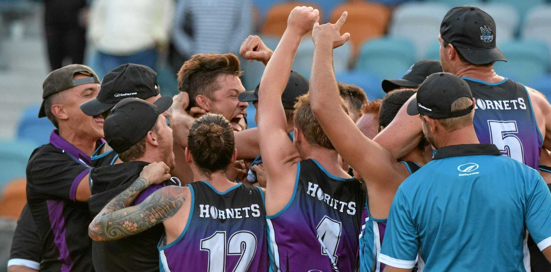 MATCH WINNER: The Hunter Western Hornets celebrate after their match winning try to defeat the Central Queensland Bulls in a thrilling National Touch League open men's grand final on Saturday at the C.ex Coffs International Stadium.