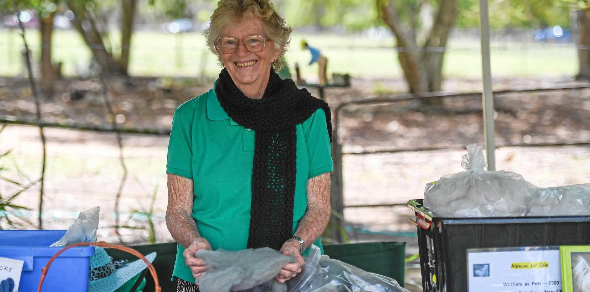 OPEN DAY: Sylvia Hyland appreciates the softness of alpaca wool at the Allyhar Alpacas open day.