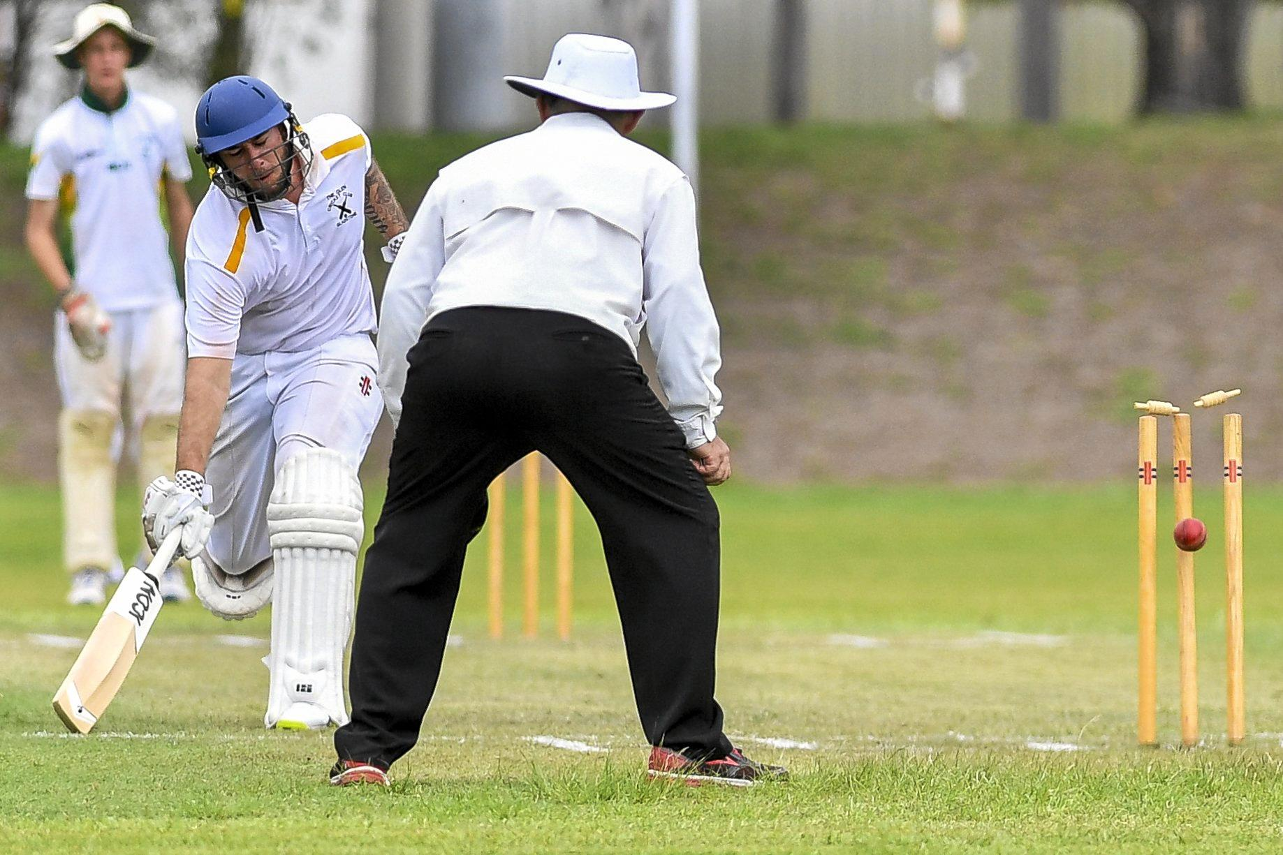 The Glen's Glen Stanton-Cook is given not out after an attempted run out.