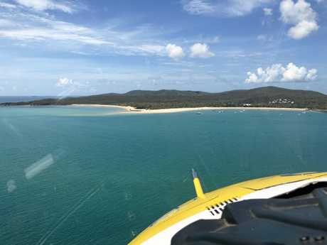 RACQ Capricorn Helicopter Rescue Service is about to land on Great Keppel Island where a man needs medical attention.