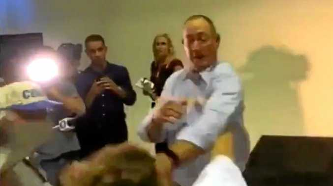 EGGING CONFRONTATION: A protester cracks an egg on Senator Fraser Anning's head during a press conference.