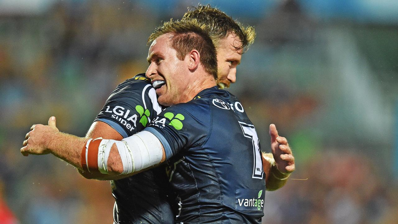 Michael Morgan celebrates his try with Cowboys teammate Gavin Cooper. Picture: Zak Simmonds