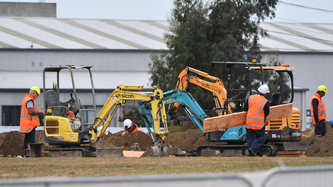 Workmen are seen digging a series of graves at the Memorial Park Cemetery in Christchurch. Picture: AAP/Mick Tsikas
