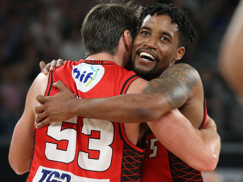 Damian Martin and Bryce Cotton celebrate after winning the NBL championship.