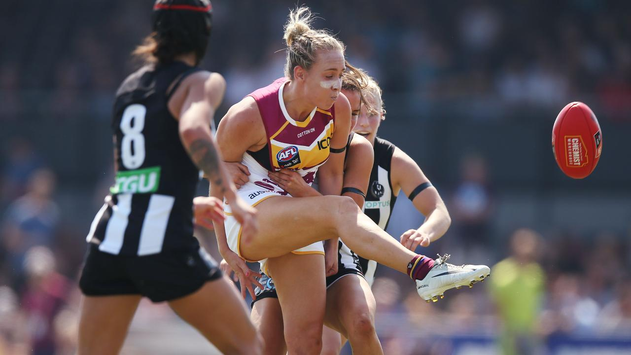 Brisbane's Lauren Arnell kicks under pressure. Picture: Getty Images