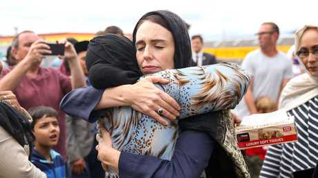 Prime Minister Jacinda Ardern hugs a mosque-goer at the Kilbirnie Mosque on March 17, 2019 in Wellington, New Zealand. Picture: Hagen Hopkins/Getty Images