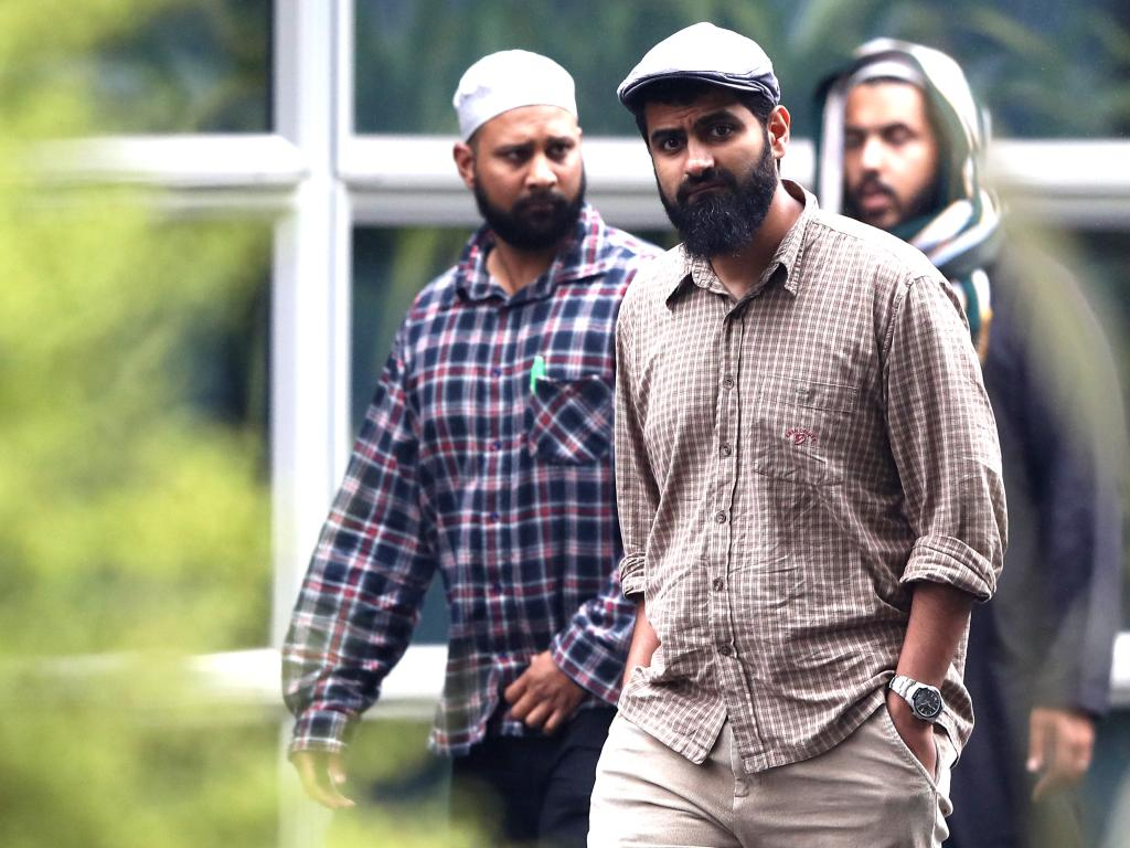 Members of the Muslim community walk back from the hospital to the community centre  in Christchurch. Picture: Getty