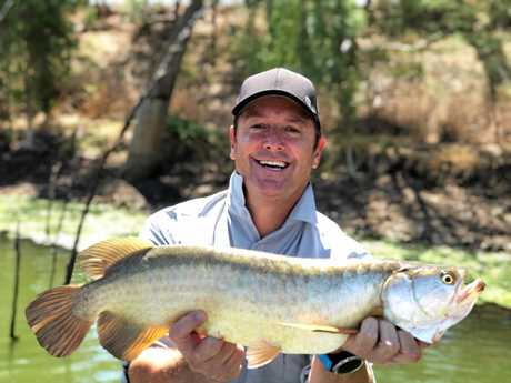 EXPOSURE: Creek to Coast host Scott Hillier with a Saratoga he caught filming with John Haenke from Guided Fishing Downunder.