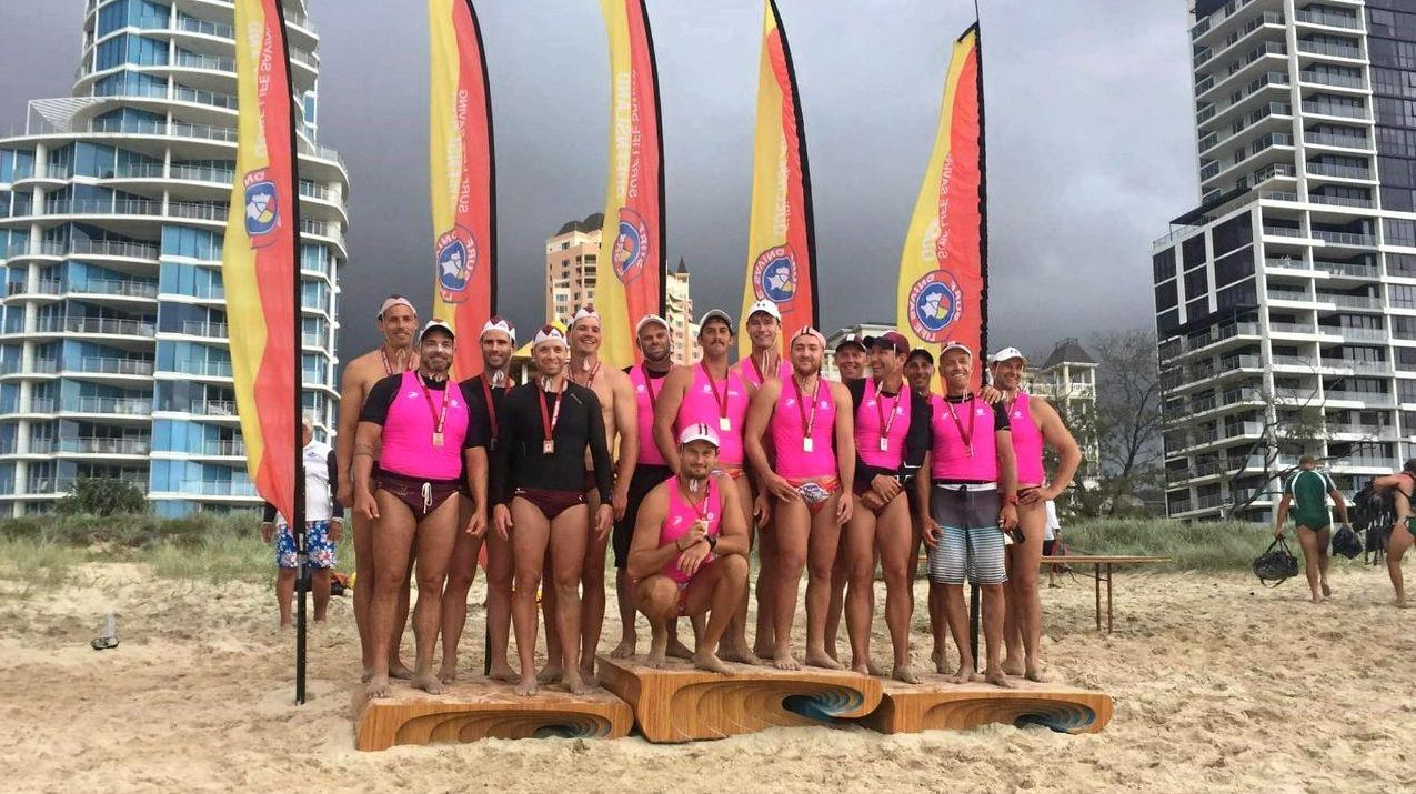 IN HONOUR OF AN ICON: The Woolgoolga Barracudas stand proudly at the top of the podium at the Queensland Titles in Broadbeach on Sunday.