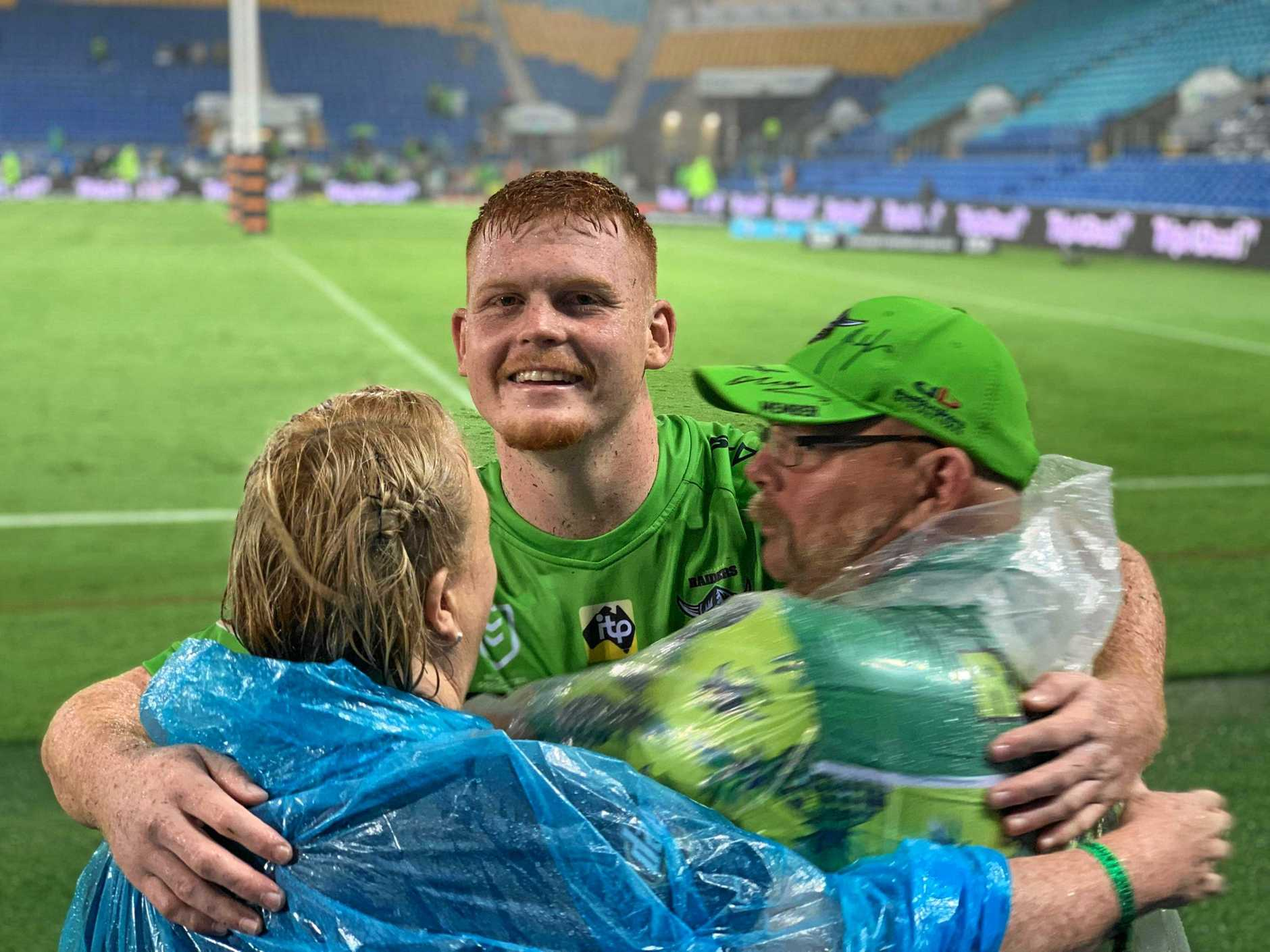 Sandy, Corey and Rick Horsburgh after the Coast junior's NRL debut for the Canberra Raiders on Sunday on the Gold Coast.