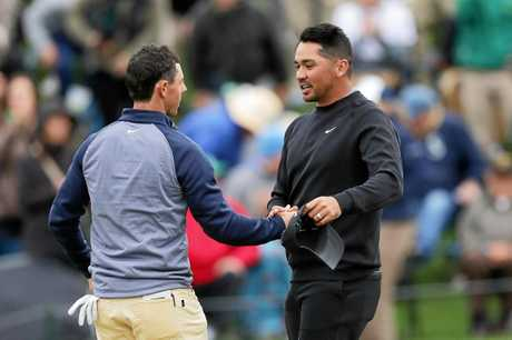 Rory McIlroy and Jason Day shake hands.