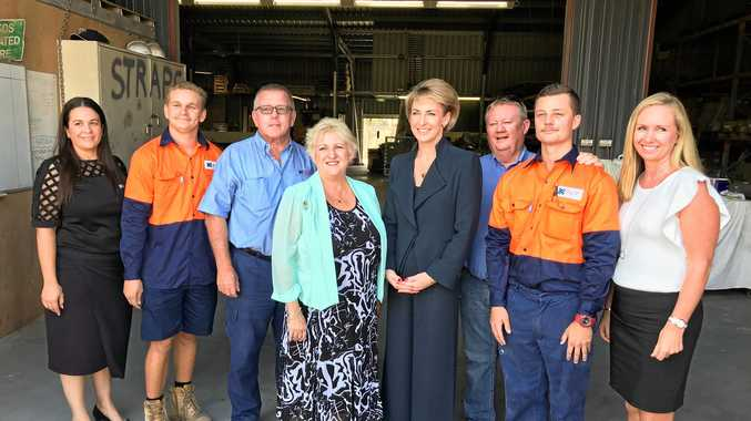 Michelle Landry MP and Small Business Minister Michaela Cash with the team at John Goss Projects' Parkhurst workshop during the minister's last visit to Rockhampton