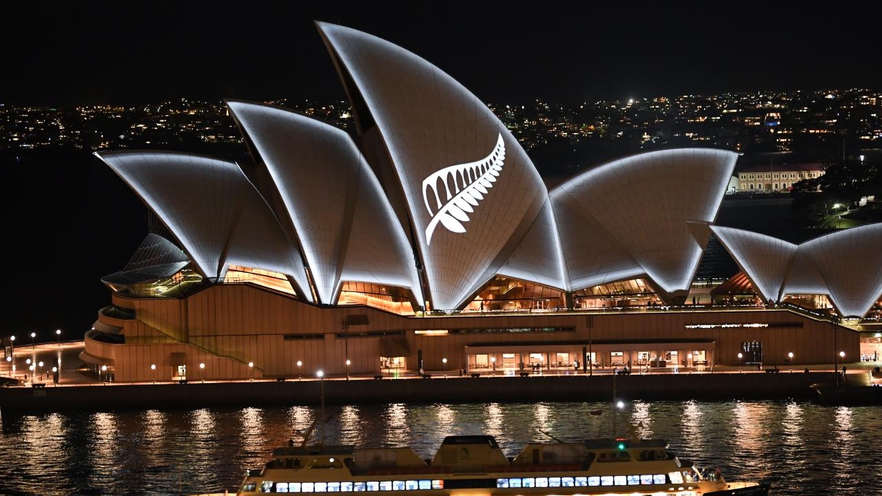 A silver fern projected onto the sails of the Opera House in commemoration of the victims of the Christchurch massacre. Picture: James D. Morgan/Getty