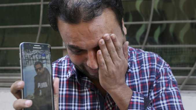 A relative weeps while showing the picture of Sohail Shahid, a Pakistani citizen who was killed in Christchurch mosque shootings. Picture: AP Photo/K.M. Chaudary