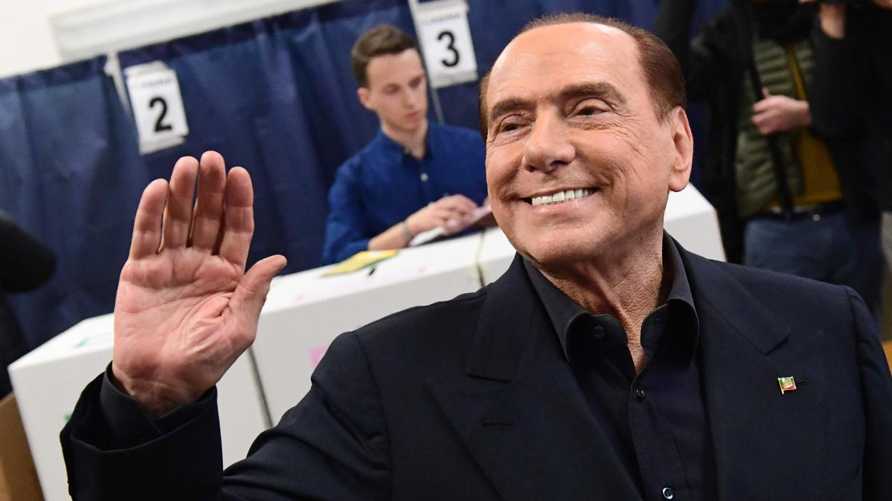 Italy's former prime minister Silvio Berlusconi, leader of right-wing party Forza Italia, waves before voting on March 4, 2018 at a polling station in Milan. Picture: Miguel Medina/AFP