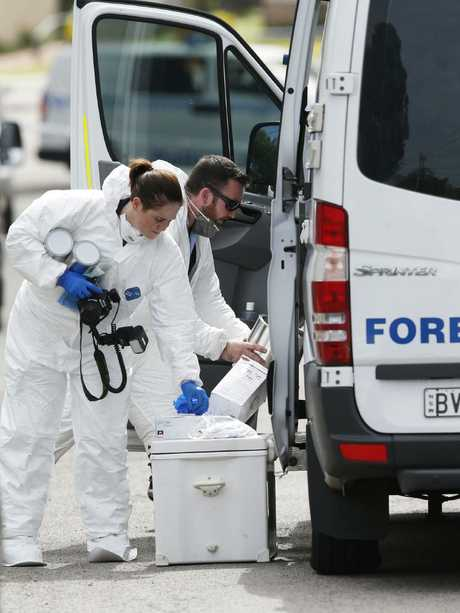 Forensic officers at the scene of