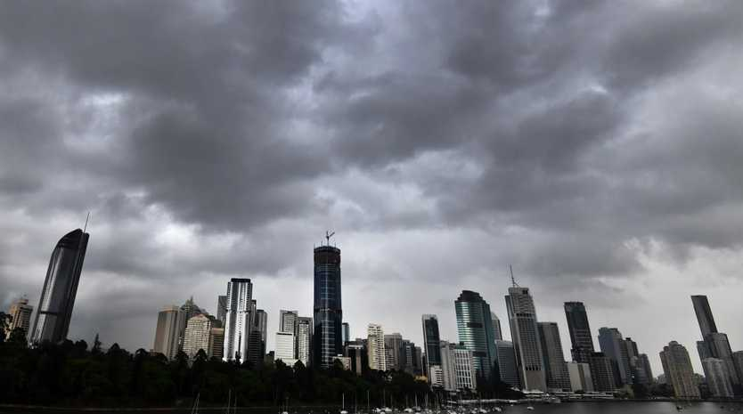 Storm clouds hover over Brisbane's CBD. Picture: AAP/File