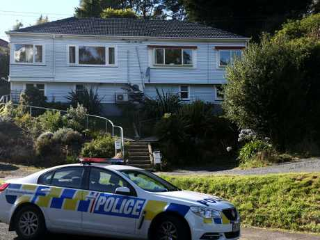 Police presence is seen at the accused gunmans' home in Dunedin, New Zealand. Picture: Getty