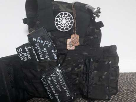 Mosque shooter Brenton Tarrant had covered his bullet-proof vest, webbing, guns and ammunition holders with white supremacist symbology, phrases and names. Picture: Twitter