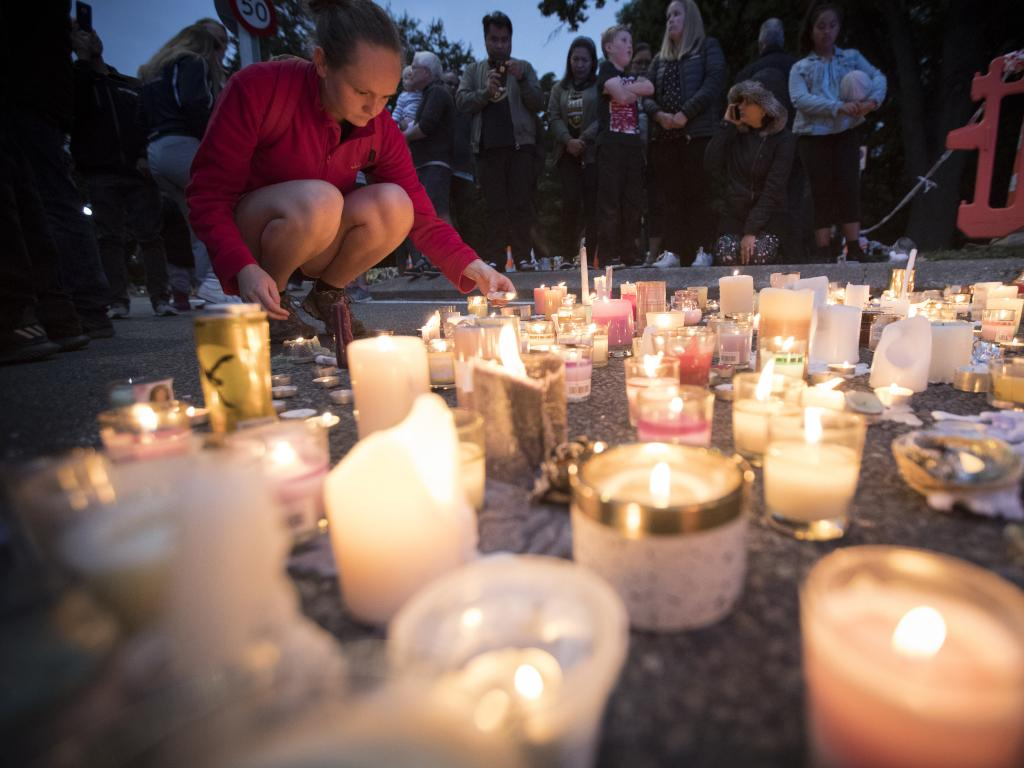 Candles are placed to commemorate victims of Friday's shooting, outside the Al Noor mosque in Christchurch. Picture: AP Photo