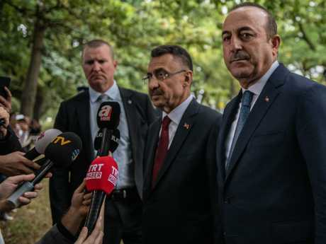 Turkey's Vice-President Fuat Oktay, right, and Foreign Minister Mevlut Cavusoglu speak to the media after visiting Al Noor mosque  in Christchurch, New Zealand. Picture: Getty