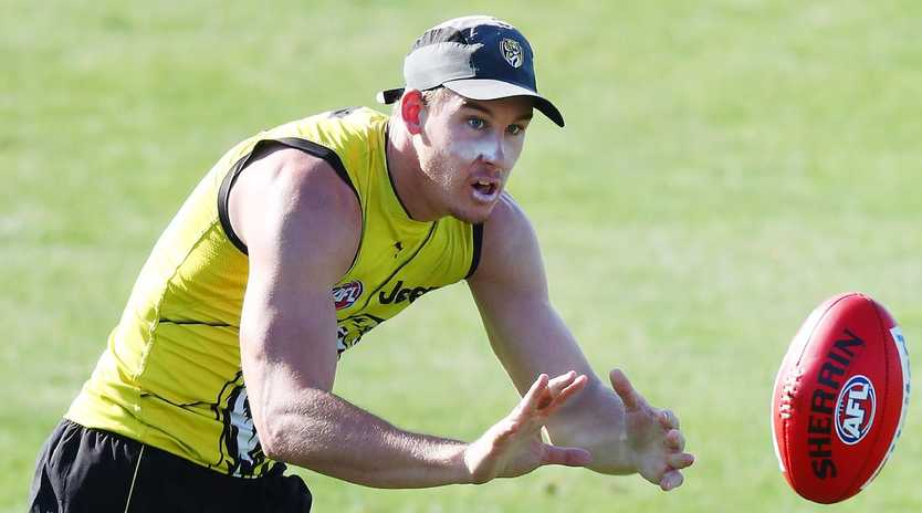 Tom Lynch runs with the ball during a Richmond Tigers AFL training session at Punt Road Oval on February 02, 2019 in Melbourne, Australia. (Photo by Michael Dodge/Getty Images)