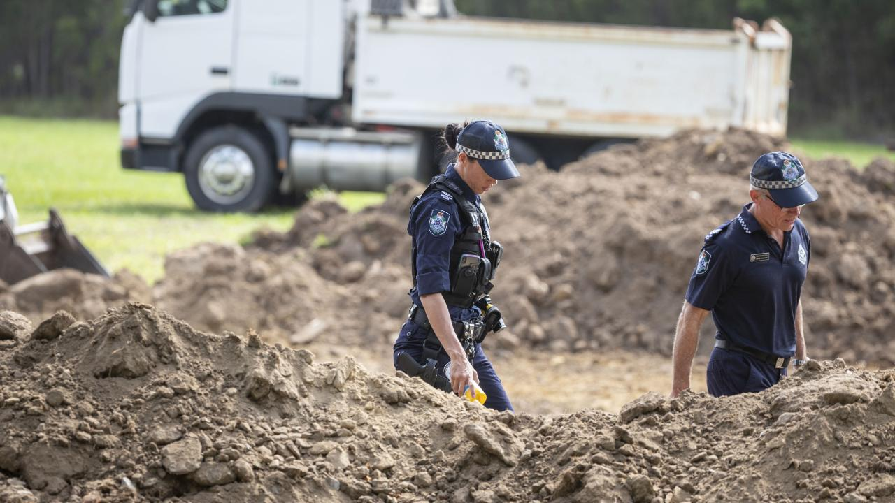 Police scour a property in Burpengary, north of Brisbane, earlier this month. The land was combed by police a week after Edmund Riggs told them where to look for his wife's remains. Picture: AAP/Glenn Hunt