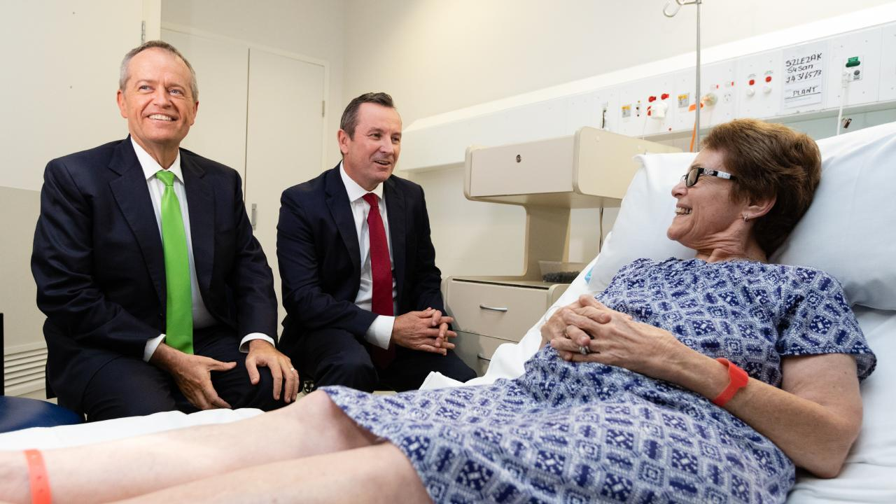 Federal Opposition Leader Bill Shorten (left) and WA Premier Mark McGowan (centre) talk with Susan Szlezak who is recovery from a hip replacement operation in Royal Perth Hospital. Picture: AAP Image/Richard Wainwright