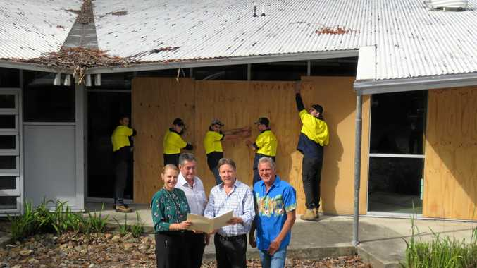 HIGH HOPES: MP Sandy Bolton, Noosa Community Training Centre boss Arthur Hartley, Mayor Tony Wellington and Cr Frank Pardon check plans while NCTC lads get to work on the Tewantin TAFE. INSET RIGHT: Damage in the main building .