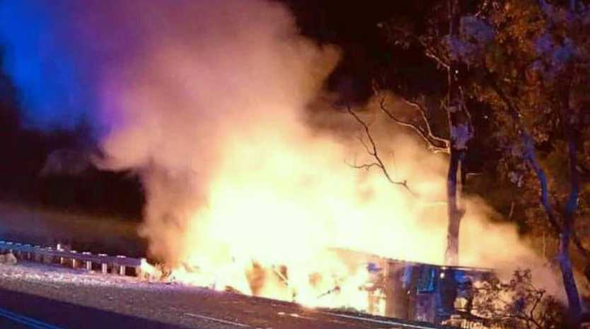 The 49-year-old Warwick driver of a semi-trailer managed to crawl free from the vehicle before it burst into flames. Picture: NSW PoliceSource:Facebook